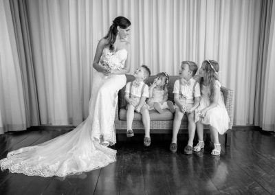 Bride with pageboys and flower girls before wedding ceremony